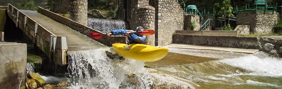 Kayak boofing off a dam